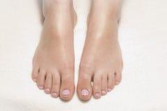 Freshly painted pink toenails Stock Photo