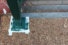 Freshly painted rail upright with paper tape masking on ground by a staircase Stock Images