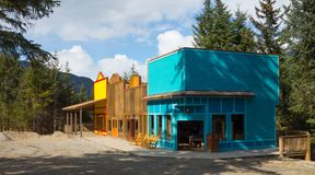 Newly built souvenir shops as seen at a remote location in alaska. Freshly painted wooden buildings constructed to sell souvenirs to tourists visiting skagway royalty free stock image