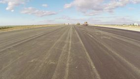 Freshly paved asphalt on an airport runway stock footage