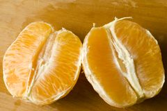 Freshly peeled organic orange Stock Images