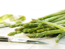 Freshly picked asparagus on white marble Stock Photography