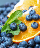 Freshly picked blueberries with orange Stock Image