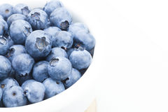 Freshly picked blueberries in white bowl - close up studio shot with focus on berries Stock Photo
