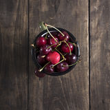 Freshly picked cherries on dark wooden table Stock Photography