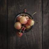 Freshly picked cherries on dark wooden table Royalty Free Stock Image