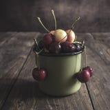 Freshly picked cherries on dark wooden table Stock Image