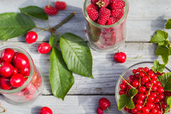Freshly picked cherries raspberry fruits table. Freshly picked cherries and raspberry fruits on the table Royalty Free Stock Photography