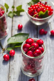 Freshly picked cherries raspberry fruits table. Freshly picked cherries and raspberry fruits on the table Royalty Free Stock Images