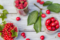 Freshly picked cherries raspberry fruits table. Freshly picked cherries and raspberry fruits on the table Royalty Free Stock Photos