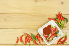 Freshly picked chili peppers on a wooden table. Preparation for the domestic processing of a crop. Royalty Free Stock Image