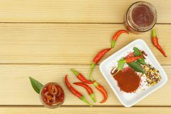 Freshly picked chili peppers on a wooden table. Preparation for the domestic processing of a crop. Royalty Free Stock Photo