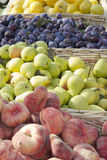 Freshly picked fruit on market stand Stock Photography