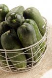 Freshly picked gherkin in a basket Stock Photo