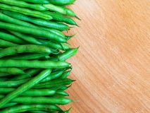freshly picked green beans on a wooden surface, copy space stock photo