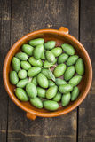 Freshly picked green olives on wooden table Royalty Free Stock Image