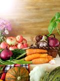 Freshly picked harvest of different autumn vegetables and fruit on a wooden background Stock Images