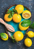 Freshly Picked Lemons With Leaves In Bright Blue Ceramic Plate Royalty Free Stock Photography