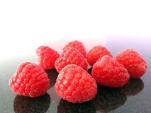 Creative fruit, bright red raspberries royalty free stock images
