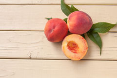Freshly picked organic peaches on a yellow table - top view Stock Photography