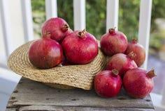 Freshly picked pomegranates displayed wood. Stock Photography