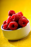 Freshly picked ripe red raspberries Stock Photos