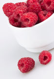 Freshly picked ripe red raspberries, isolated on white Stock Photos