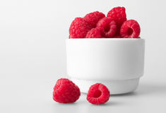 Freshly picked ripe red raspberries, isolated on white Stock Image