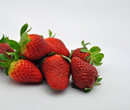 Freshly picked strawberries. Close up of a group of freshly picked strawberries set against a light blue background Stock Photos
