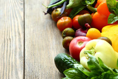 Freshly picked vegetables on a wooden surface Stock Image