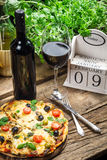 Freshly pizza served with red wine Royalty Free Stock Image
