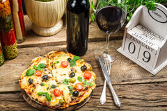 Freshly pizza served with red wine Stock Photos