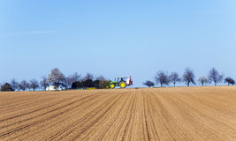Freshly ploughed acre with row Stock Photo