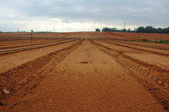 Freshly plowed farm field. Freshly tilled farm field ready for planting Royalty Free Stock Photography