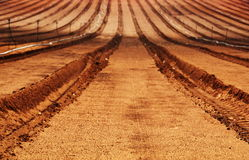 Freshly plowed farm field Stock Images