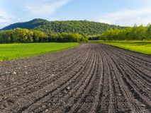Free Freshly Plowed Field In Spring Royalty Free Stock Photos - 147671918