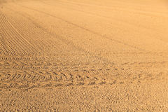 Freshly plowed field with marks of tire Stock Photography