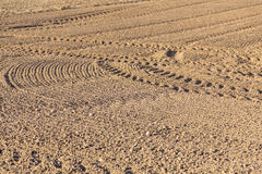 Freshly plowed field with marks of tire Stock Photo