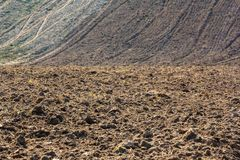 Freshly plowed field ready for planting and seeding in spring stock photography