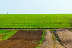 Freshly plowed field ready for planting and seeding in spring stock images