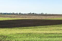 Freshly plowed field in spring is ready for cultivation.  Zhytomyr region, Ukraine. Stock Photos
