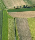 Freshly plowed and sowed farming land from above Stock Photo