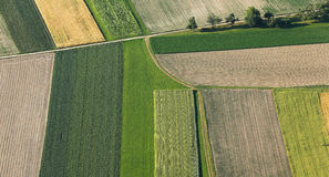 Freshly plowed and sowed farming land from above Royalty Free Stock Photo