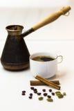 Freshly prepared aromatic coffee with cinnamon and cardamom Royalty Free Stock Photos