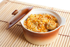 Freshly prepared Asian risotto with beef. On white Royalty Free Stock Images