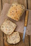 Freshly prepared bread, cut into slices with seeds of flax. Sesame, oats and dried carrots, top view Royalty Free Stock Images