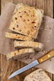 Freshly prepared bread, cut into slices with seeds of flax stock image