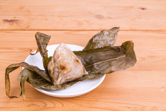 Freshly prepared Chinese rice dumpling or zongzi unwrapped on pl Stock Photography