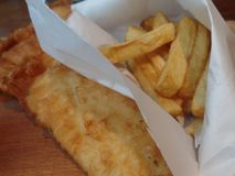 Freshly prepared cod and chips royalty free stock photo