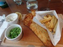 Freshly prepared cod and chips stock photography